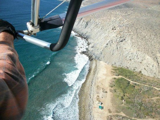 Ultra-lite flight take off right from the beach at Rancho Pescadero