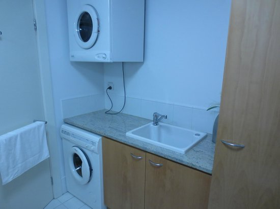 Light's Landing Apartments: Typical bathroom with washing machine and clothes dryer