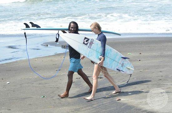 The Chillhouse - Bali Surf and Bike Retreats: Surfing at a beach near Tanah Lot