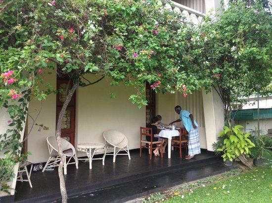 Royal Tourist Lodge: My kids enjoying breakfast on the verandah