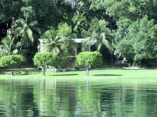Hotel Bahia Taitza: View of our 4 room building from boat on the lake