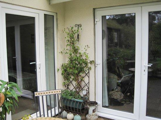 The dining/sitting room doors and bedroom door to garden