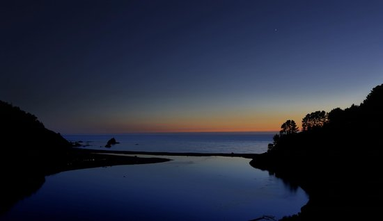Alegria Oceanfront Inn and Cottages: Cove 10 miles south with Venus visible in sky