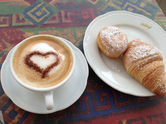 Hotel Suisse: Capuccino with Brioche....Yummy!