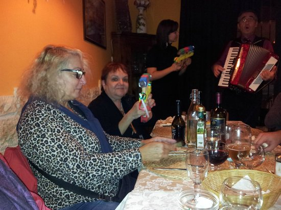 Opera Ristorante: One of the collegues participates with the singers