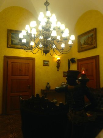 Hotel U Prince: Chandelier outside the room, cosy area to relax in