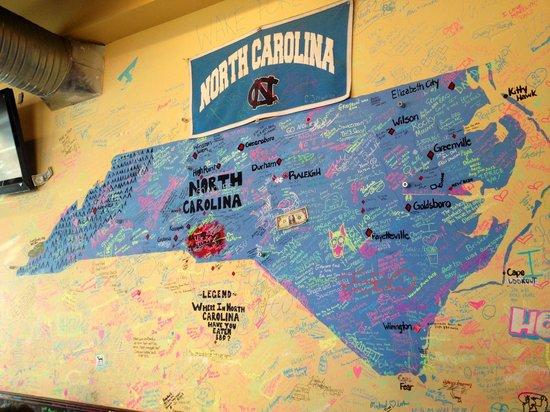 Sauceman's walls of artwork- customer contributions!