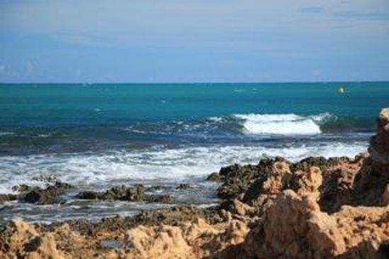 Playa de Cabo Roig: Rocky shore beyond the marina