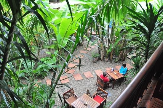 Lotus Villa Boutique Hotel: garden dining area seen from second floor balcony