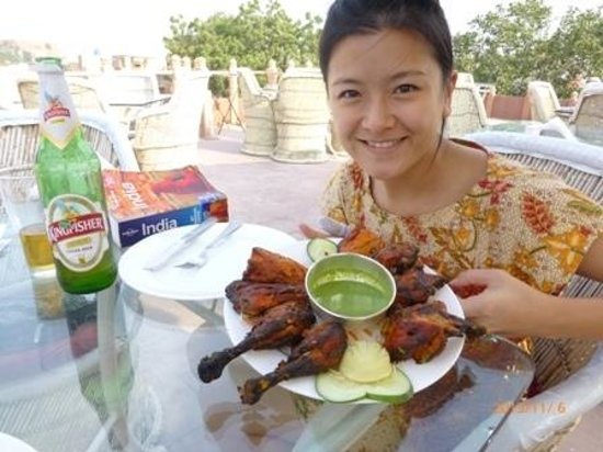 Pal Haveli: full tandoori chicken at roof top restaurant, best we ever had. Cold beer, nice breeze.