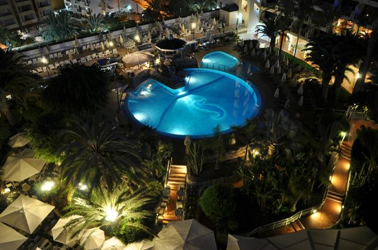 Seaside Sandy Beach: View from our room at night of the pool and terrace