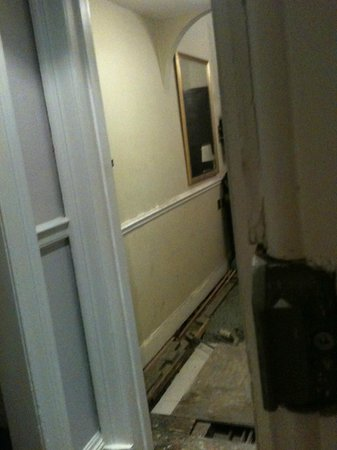 Royal Overseas League : Room 9 - floor ripped up due to a leak/flood