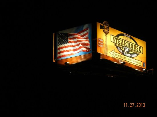 Stroke's Bar & Grill: Night shot of the new sign.