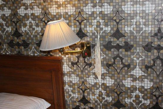 Qutub Residency: peeling wall paper