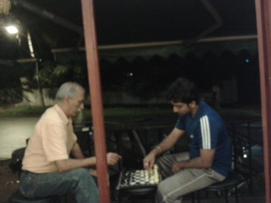 Tina's Cafe: Is anybody interested in chess with the owner ? (The uncle in peach coloured shirt.