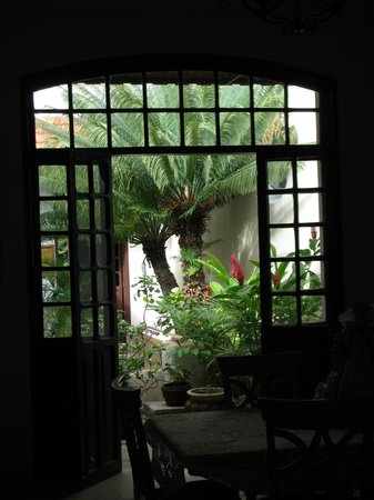 Casa Santiago: view from one of the dining areas to the grounds