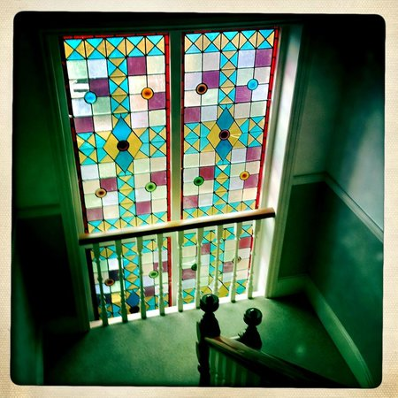 The Cloudesley: Stain glass window on stairs