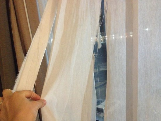 Holiday Inn Hotel & Suites - North: Ripped old curtains