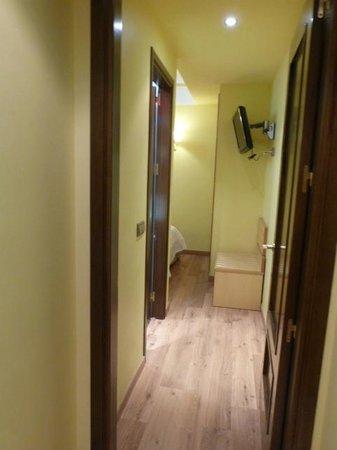 Suites Gran Via 44: Hallway looking towards the bedrrom,  door to the room is on the right