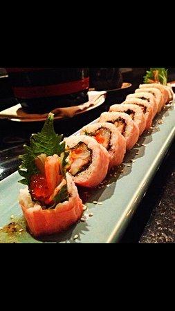 Sushi boat at gaia sushi bar restaurant fotograf a de for Blue fish sushi menu