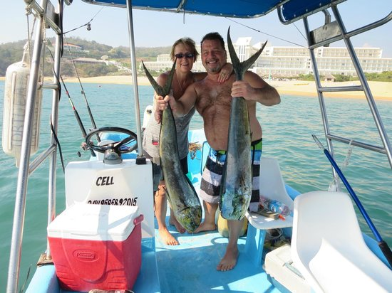 Secrets Huatulco Resort & Spa: Deep Sea Fishing with the hotel in the background