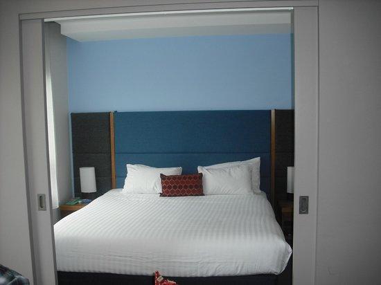 The Sebel Launceston: Bedroom showing doors which close it off