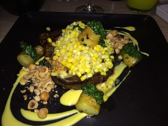 George's at the Cove: Entree- 28 day dry aged ribeye, roasted new potatoes, hazelnuts, onions, chimichurri, corn