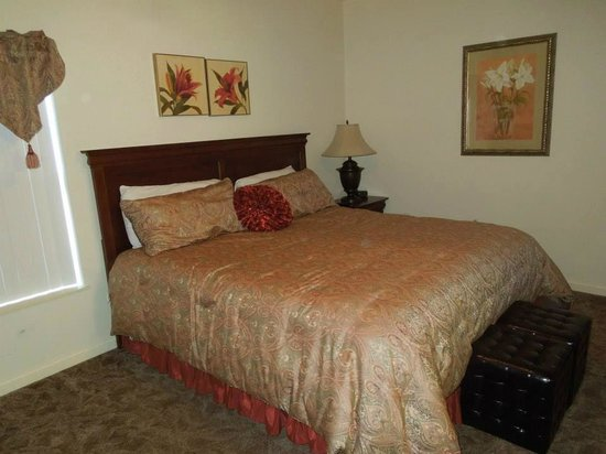 Whispering Pines Condominiums: Bedroom with kingsize bed