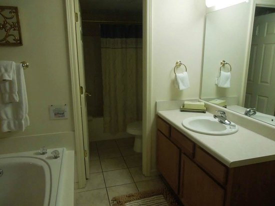 Whispering Pines Condominiums: The sink and jacuzzi tub is in bedroom. The toilet and smaller tub is through the door you see..