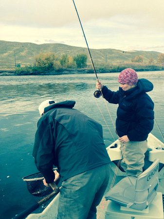 Gallatin River Guides: My wife releasing a cutthroat