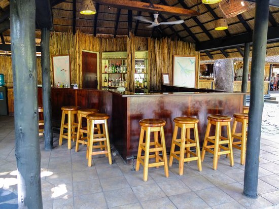 Camp Okavango: The Bar.  Well-Stocked and a Great Location to Share Your safari Tales.