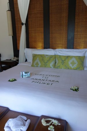 "Anantara Mai Khao Phuket Villas: ""welcome"" message spelled out on bed in villa"