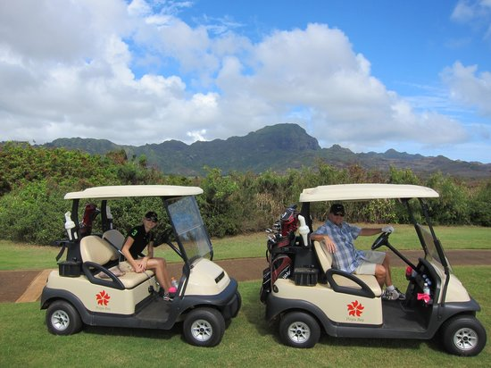 Poipu Bay Resort Golf Course: My husband and daughter in the carts