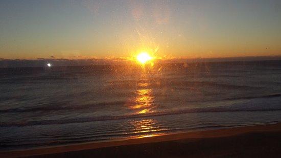 Marigot Beach Suites: sunrise from master bedroom window