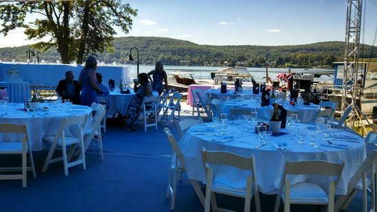 Tables and chairs on the stage for a wedding at the Lake House.
