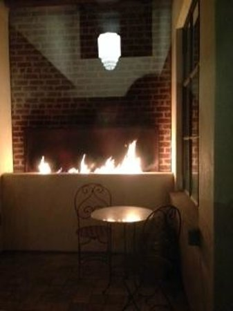 Granada Hotel and Bistro: Private Fireplace Courtyard With Adjoining Rooms. Good for Friends --like a Jack & Jill Fireplac