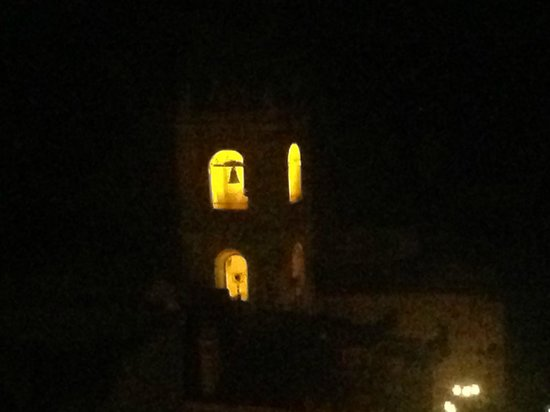 Hotel Taodomus: Night time view of local campanile from roof top terrace