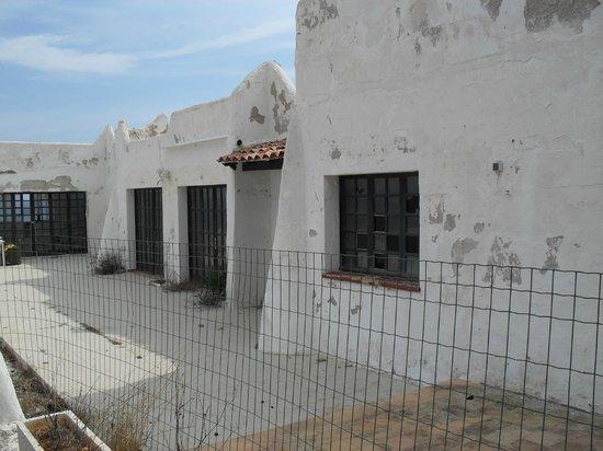 Roca Serena Apartments: Former reception area, fenced off & derelict, with broken windows.