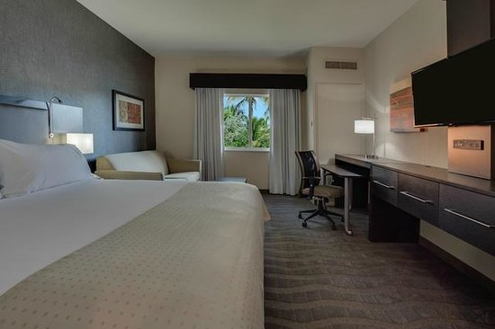 Holiday Inn Express & Suites Naples: King Bedded Room, featuring pull out sofa sleeper, refrigerator and microwave!
