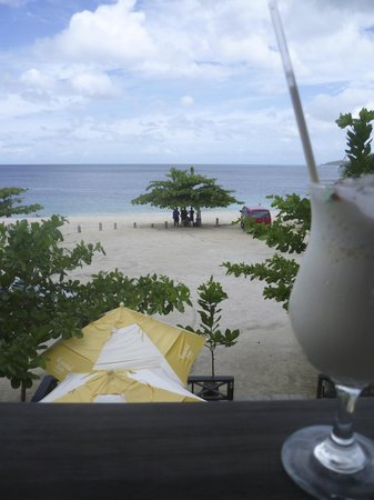 Umbrellas Beach Bar : View from upstairs patio with milkshake in fg.