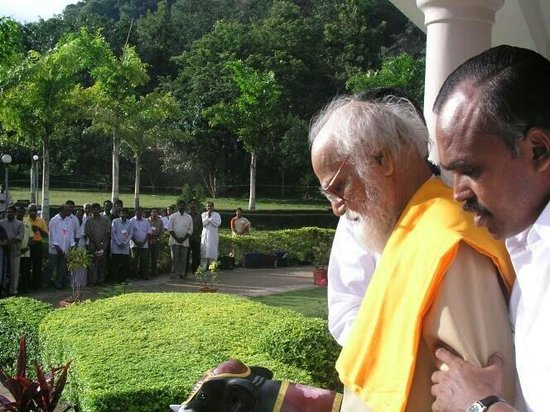 Pollachi, India: Maharishi coming out from ohm kara mandapam