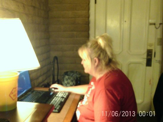 Landmark Lookout Lodge: me,,taking care of bussiness,,while using the FREE WIFI,,,they offer in room....