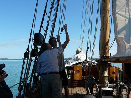 R. Tucker Thompson: Helping to raise the mainsail.