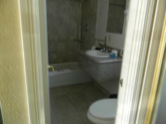 The Wilkie's Inn - Clarion Collection: Room 106 granite sinktop, with bathtub