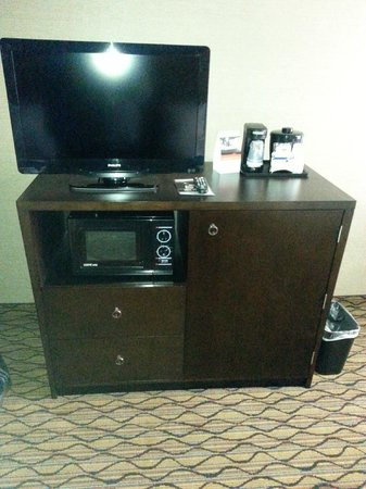 Holiday Inn Express Port Hueneme: Entertainment center with microwave and fridge behind right door