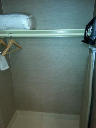 Holiday Inn Express Port Hueneme : open closet which is in front of the sink and mirror