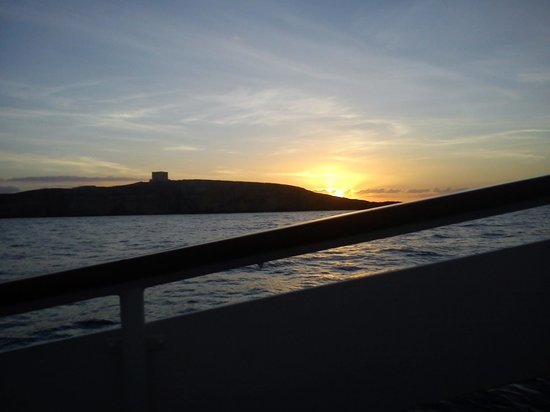 Comino Hotel: Sunrise over Comino from the hotel boat.