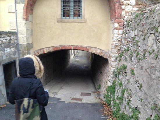 Siena Walking Tours - Private Guided Tours: Constanza leading a quick walk through the medieval passage at Radda in Chianti