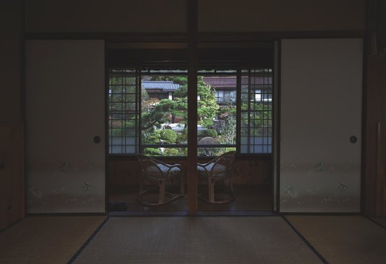 Ryokan Fujioto: View towards the entrance to our room and private seating area overlooking the front garden