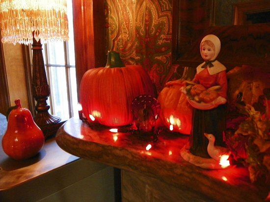 Victorian Mansion: The decorations were enhanced by beautiful Thanksgiving arrangements.